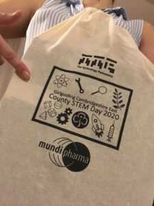 A tote bag with the Girlguiding Cambridgeshire East County STEM day 2020 badge printed on it